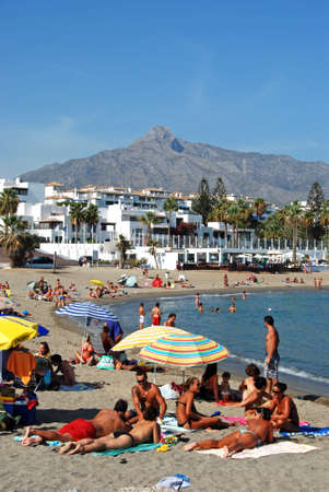 holidaymaker: Holidaymakers relaxing on Playa de Nueva beach, Puerto Banus, Marbella, Costa del Sol, Malaga Province, Andalusia, Spain, Western Europe. Editorial