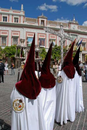 brotherhood: Members of El Cerro brotherhood walking through the city streets during Santa Semama, Seville, Seville Province, Andalusia, Spain, Western Europe.