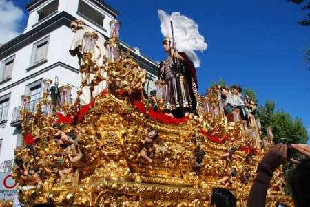 San Benito brotherhood float moving through the city streets during Santa Semama, Seville, Seville Province, Andalusia, Spain, Western Europe.