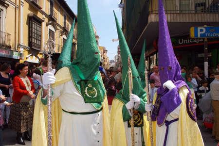 semana: Members of the Pollinca brotherhood walking through the city centre during Santa Semana, Malaga, Malaga Province, Andalusia, Spain, Western Europe.