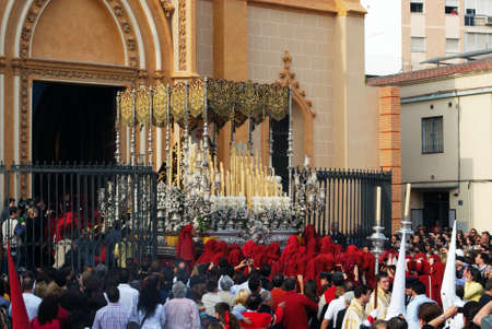 Members of the Salud Brotherhood carrying the float out of the San Pablo (Saint Paul) church during Santa Semana week, Malaga, Malaga Province, Andalusia, Spain, Western Europe. Editorial
