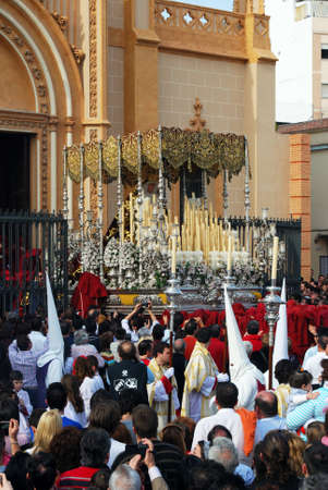 semana: Members of the Salud Brotherhood carrying the float out of the San Pablo (Saint Paul) church during Santa Semana week, Malaga, Malaga Province, Andalusia, Spain, Western Europe. Editorial