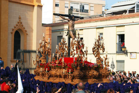 carrying the cross: Members of the Salud Brotherhood carrying the float with Christ from the San Pablo (Saint Paul) church during Santa Semana week, Malaga, Malaga Province, Andalusia, Spain, Western Europe. Editorial