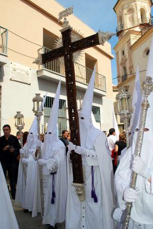 salutation: Members of the Salutation brotherhood walking through the city streets during Santa Semana week, Malaga, Malaga Province, Andalusia, Spain, Western Europe.