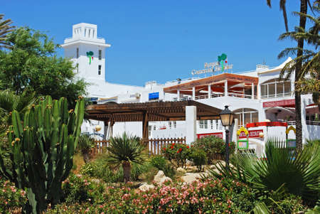 shopping centre: Shopping centre with pretty flowerbeds in the foreground, Mojacar, Almeria Province, Andalusia, Spain, Western Europe.