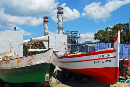 petrochemical: Traditional wooden fishing boats with petrochemical oil refinery to the rear, Puente Mayorga, Cadiz Province, Andalusia, Spain, Western Europe. Editorial