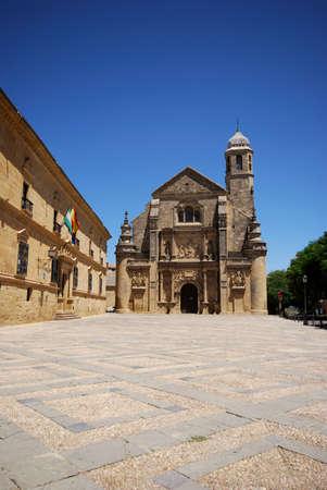 plateresque: The Sacred Chapel of El Salvador (Capilla del Salvador) in the Plaza de Vazquez de Molina with the Parador hotel to the left, Ubeda, Jaen Province, Andalusia, Spain, Western Europe.