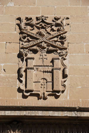 plateresque: Coat of arms on the wall of the town hall (Ayuntamiento Antigua Carcel), Baeza, Jaen Province, Andalusia, Spain, Western Europe. Stock Photo