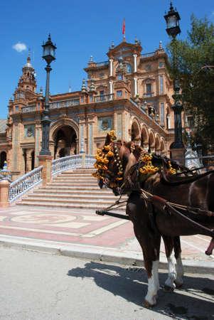 horse drawn carriage: Horse drawn carriage in the Plaza de Espana, Seville, Seville Province, Andalusia, Spain, Western Europe. Stock Photo