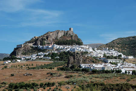 View of the town with a castle on top of the hill, Zahara de la Sierra, Cadiz Province, Andalucia, Spain, Western Europe.