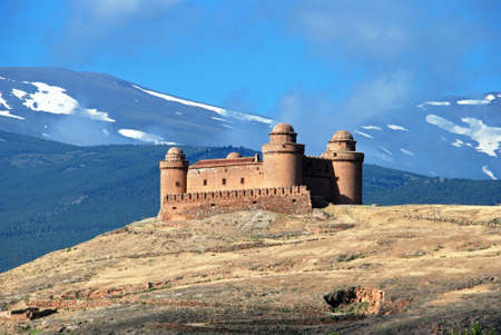 snow capped mountains: View of the castle (Castillo de La Calahorra) with the snow capped mountains of the Sierra Nevada to the rear La Calahorra, Granada Province, Costa Almeria, Andalusia, Spain, Western Europe. Editorial