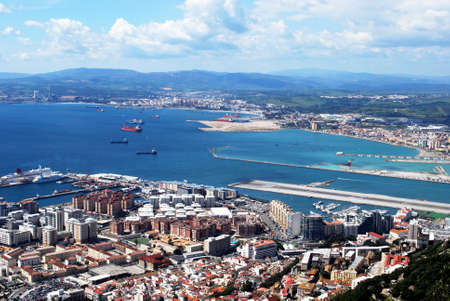 elevated view: Elevated view over town and airport runway from cable car station with the Spanish coastline to the rear, Gibraltar, United Kingdom, Western Europe.