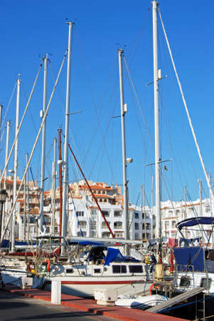 western europe: Yachts in the marina with apartments to the rear, Almerimar; Almeria Province, Andalusia, Spain, Western Europe.