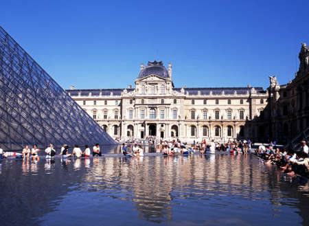 louvre pyramid: View of the Louvre Museum and the Pyramid with tourists enjoying the Summer sunshine, Paris, France, Western Europe