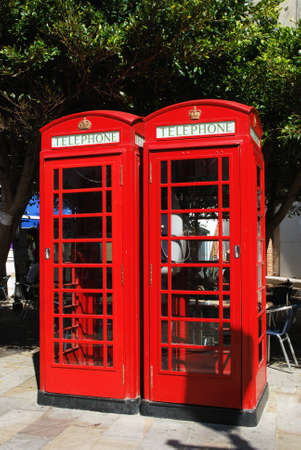 british weather: British telephone boxes in the town centre, Gibraltar, United Kingdom, Western Europe. Stock Photo