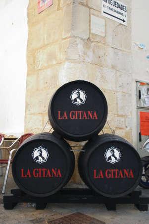 casks: La Gitana sherry casks on the pavement, Sanlucar de Barrameda, Cadiz Province, Andalusia, Spain, Western Europe.