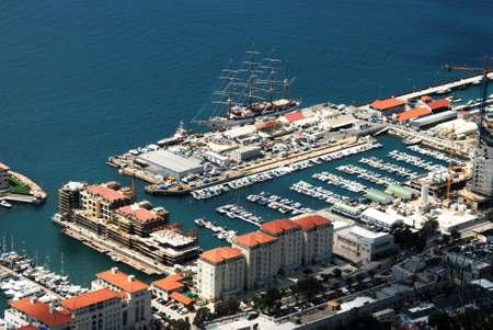 elevated view: Elevated view of the marina area with a tall ship moored, Gibraltar, United Kingdom, Western Europe.