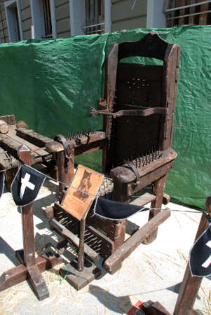 western europe: Medieval torture chair with spikes at the Medieval market, Barbate, Cadiz Province, Andalusia, Spain, Western Europe.