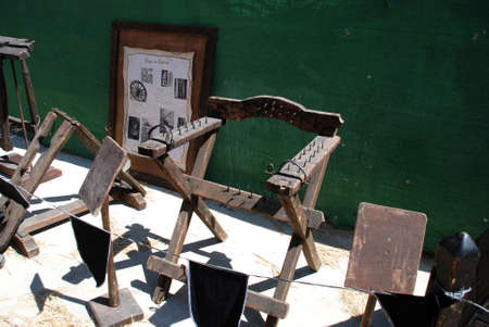 barbaric: Medieval torture chair with spikes at the Medieval market, Barbate, Cadiz Province, Andalusia, Spain, Western Europe.