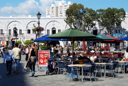 alfresco: Tourists relaxing at pavement cafes in Grand Casemates Square, Gibraltar, United Kingdom, Western Europe. Editorial