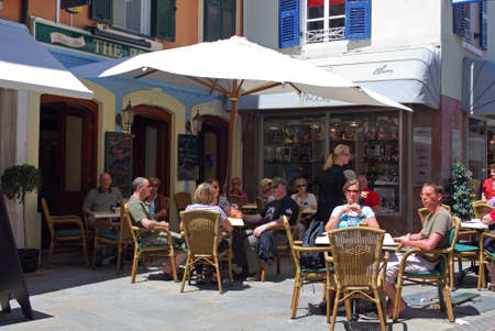 western europe: Tourists relaxing at a bar along Main Street, Gibraltar, United Kingdom, Western Europe.