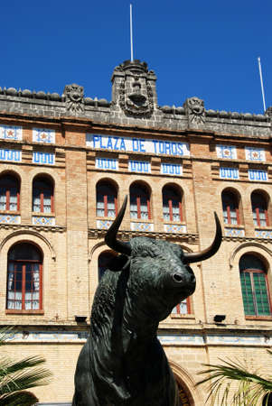toros: Exterior view of the bullring (Plaza de Toros) with a bull statue in the foreground, El Puerto de Santa Maria, Cadiz Province, Andalusia, Spain, Western Europe. Editorial