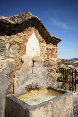 balcon: Stone drinking fountain along the Balcon del Adarve with views towards the countryside, Priego de Cordoba, Cordoba Province, Andalusia, Spain, Western Europe.side. Stock Photo