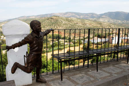 balcon: Statue of a boy along the Balcon del Adarve with olive groves in the Spanish countryside to the rear, Priego de Cordoba, Cordoba Province, Andalusia, Spain, Western Europe.