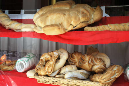 speciality: Speciality bread in a bakers window, Priego de Cordoba, Cordoba Province, Andalusia, Spain, Western Europe.