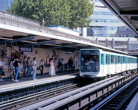 metro train: Metro train alongside the platform at Bastille railway station with passengers waiting, Paris, France, Western Europe. Editorial