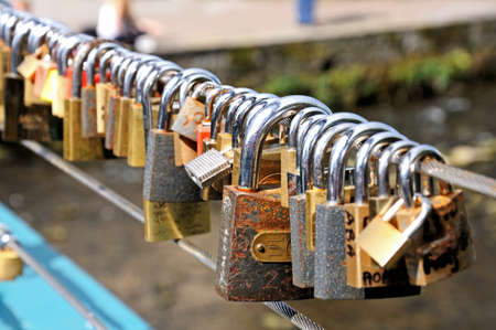 western europe: Love locks attached to the cable bridge, Bakewell, Derbyshire, England, UK, Western Europe.