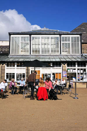 derbyshire: Pavement cafe in the Pavilion Gardens, Buxton, Derbyshire, England, UK, Western Europe.