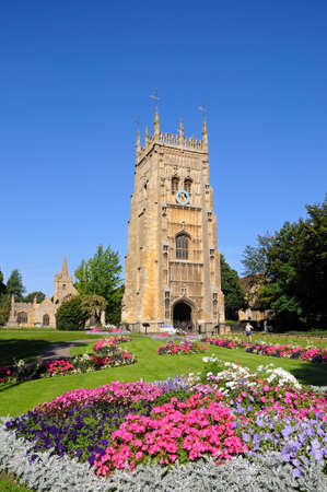 flowerbeds: Abbey clock tower and flowerbeds in Abbey Gardens with St Lawrence church to the rear, Evesham, Worcestershire, England, UK, Western Europe.