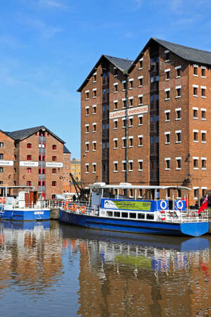 gloucestershire: Pleasure boats moored in Gloucester Docks with warehouses to the rear, Gloucester, Gloucestershire, England, UK, Western Europe.