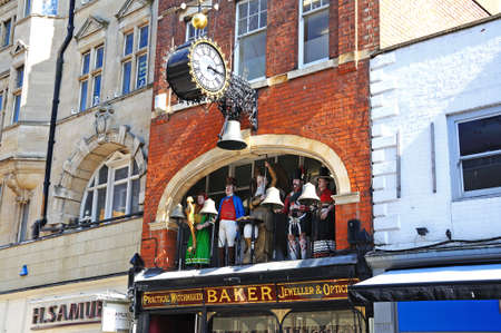 Bakers Jewellers with statues and a clock above along Southgate Street, Gloucester, Gloucestershire, England, UK, Western Europe.