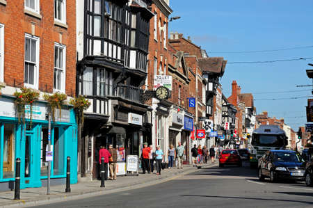 View of shops and shoppers along the High Street, Tewkesbury, Gloucestershire, England, UK, Western Europe.