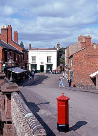 country living: View along the main Victorian shopping street with a post box in the foregroundat the Black Country Living Museum, Dudley, West Midlands, England, UK, Western Europe. Editorial