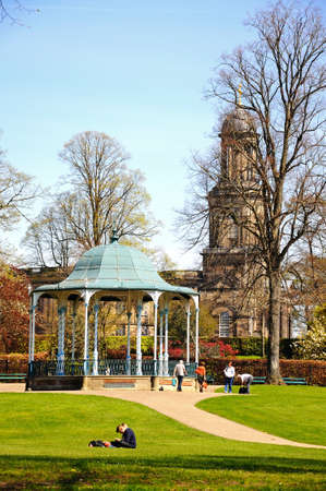 bandstand: View of St Chads church with a bandstand in the foreground and people enjoying the sunshine, Shrewsbury, Shropshire, England, UK, Western Europe.