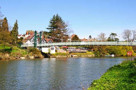 public house: Porthill Suspension Bridge across the River Severn with the Boathouse Public House to the rear, Shrewsbury, Shropshire, England, UK, Western Europe.