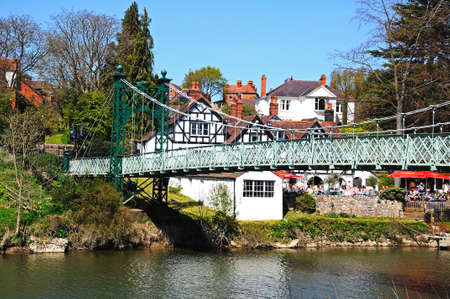 severn: Porthill Suspension Bridge across the River Severn with the Boathouse Public House to the rear, Shrewsbury, Shropshire, England, UK, Western Europe.
