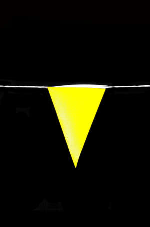 flack: Yellow pennant flag against a flack background.
