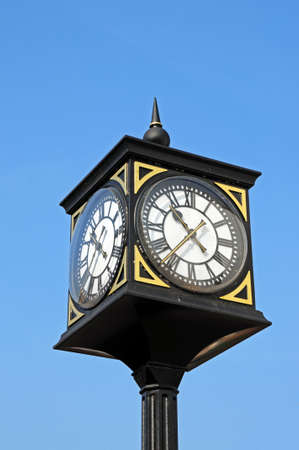 stafford: Ornate clock in a black and gilt iron frame in the town centre, Stafford, Staffordshire, England, UK, Western Europe.