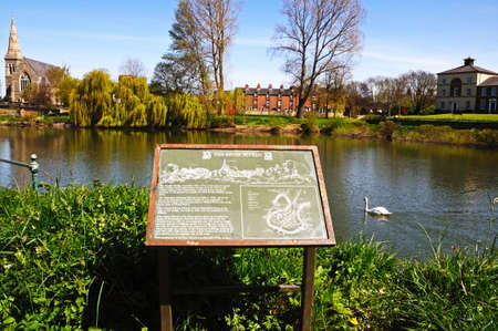 severn: Information sign along the River Severn with a mute swan to the right hand side, Shrewsbury, Shropshire, England, UK, Western Europe.