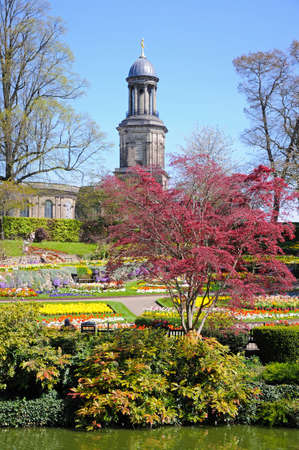 View of The Dingle formal garden in Quarry Park during the Springtime with St Chads church to the rear, Shrewsbury, Shropshire, England, UK, Western Europe. Stock Photo