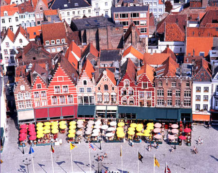 market place: Elevated view of pavement cafes and buildings in the Market Place Bruges Belgium Western Europe. Editorial