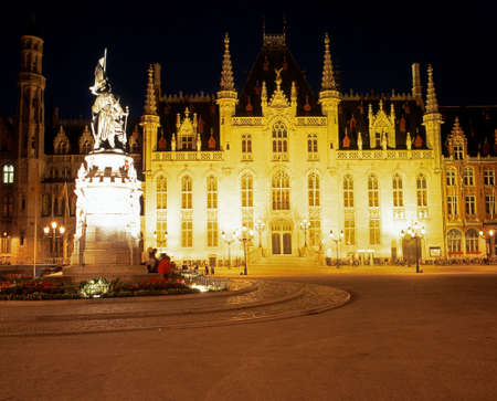 market place: The Government palace in the Market Place lit up at night Bruges Belgium Western Europe.