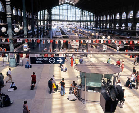 france station: Trains alongside platforms in the Gare du Nord railway station with passengers waiting Paris France Western Europe.