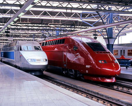 TGV train of French Railways and Thayls 2 in the Brussels Midi Station Brussels Belgium Western Europe.