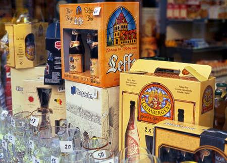 mementos: Shop window with Belgian beers bottles carrypacks and glasses Bruges Belgium Western Europe.