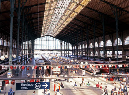nord: Trains alongside platforms in the Gare du Nord railway station with passengers waiting Paris France Western Europe.